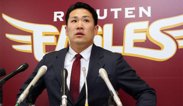 Japanese star pitcher Masahiro Tanaka of Rakuten Eagles speaks before the press after meeting with his team's president in Sendai in Miyagi prefecture, northern Japan on Tuesday.