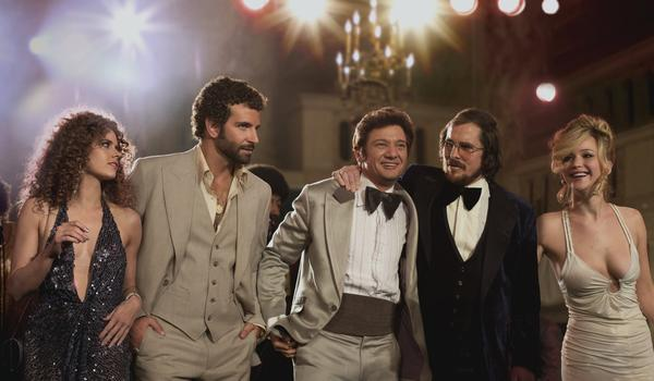 "Amy Adams, from left, Bradley Cooper, Jeremy Renner, Christian Bale and Jennifer Lawrence star in ""American Hustle."""