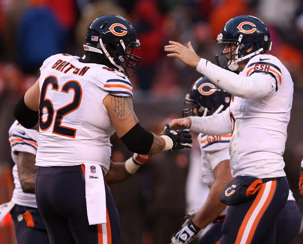 Bears quarterback Jay Cutler (6) celebrates with teammate Eben Britton (62) after a touchdown run by running back Michael Bush in the fourth quarter Sunday.