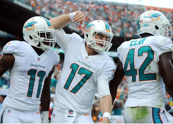 Miami Dolphins' Ryan Tannehill celebrates a touchdown with Mike Wallace against the New England Patriots at Sun Life Stadium in Miami Gardens, Fla., on Sunday, Dec. 15, 2013. Miami won, 24-20. (Jim Rassol/Sun Sentinel/MCT)