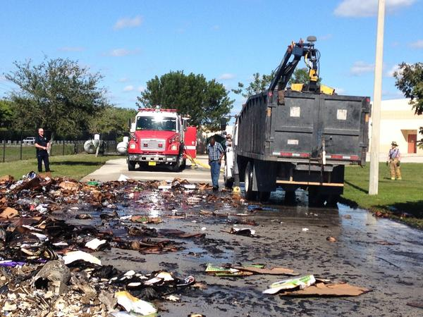 Palm Beach firefighters extinguished a blaze that was burning inside a recycling truck outside Polo Park Middle school.