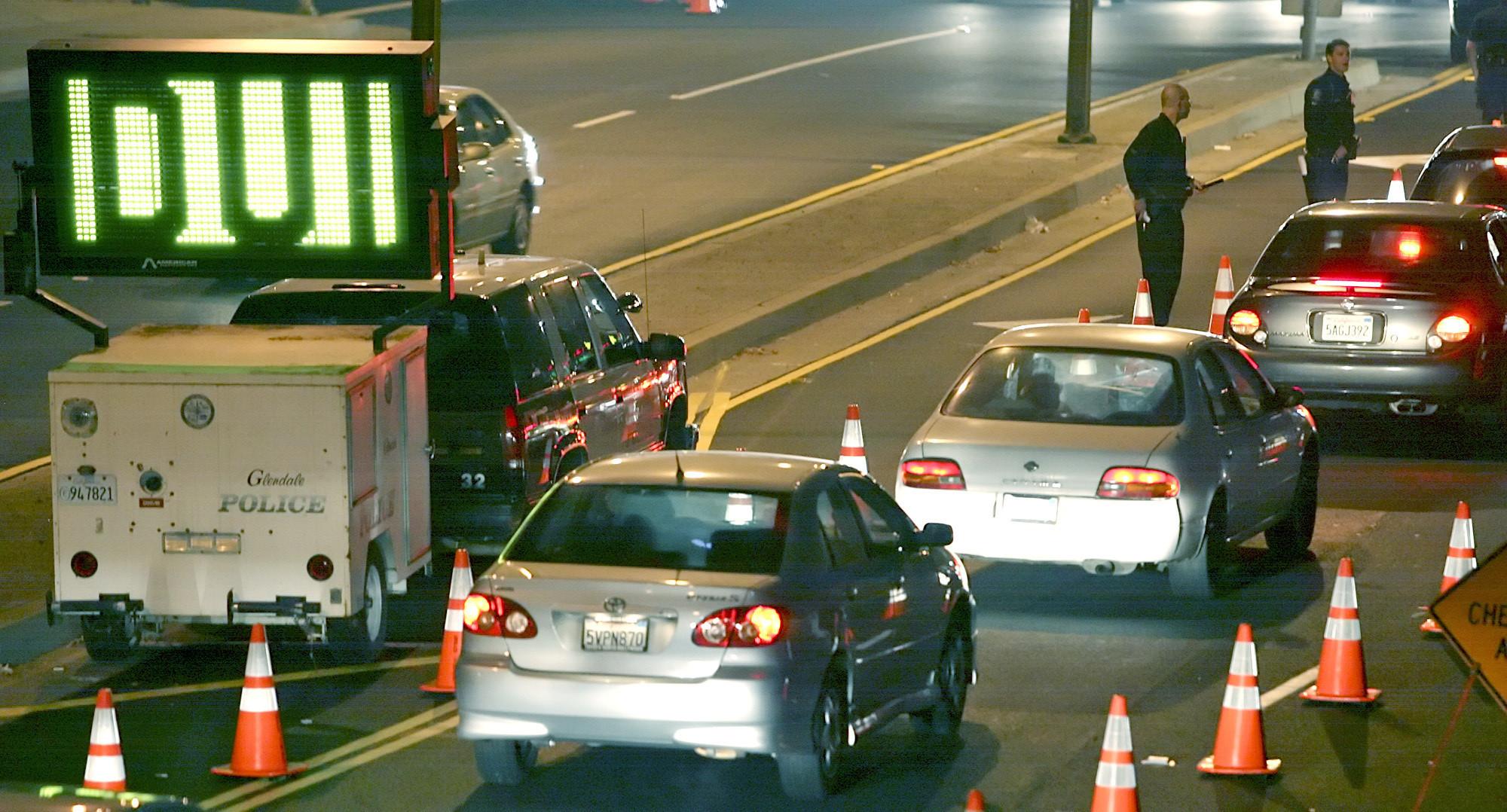 Cars line up at a DUI checkpoint on Los Feliz Boulevard at San Fernando Road in Glendale. (Roger Wilson / Glendale News Press)