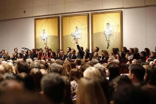 "Bidders compete for Francis Bacon's ""Three Studies of Lucian Freud,"" at a Christie's auction in November in New York."