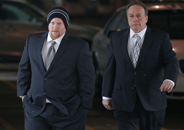 Former Maine West soccer coach Michael Divincenzo, left, walks into the Cook County Circuit Court in Skokie on Tuesday. Divincenzo is charged with misdemeanor counts of hazing, battery and failing to report abuse.