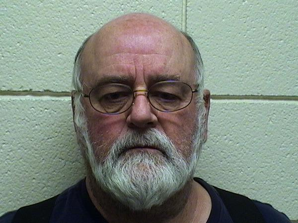 Richard Cote, 67, faces charges of interfering with an officer and disobeying the signal of an officer after he failed to move his car out of the way for an ambulance and became argumentative with police.