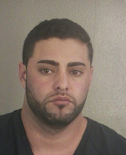 Axel E. Inostroza has been arrested in a hit-and-run case in which the victim remained atop a Mustang during a nearly two-mile drive from Fort Lauderdale to Pompano Beach, police said.