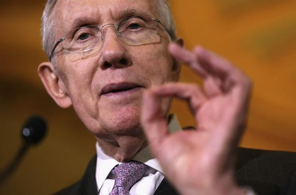 Reid seeks holiday deal on nominations