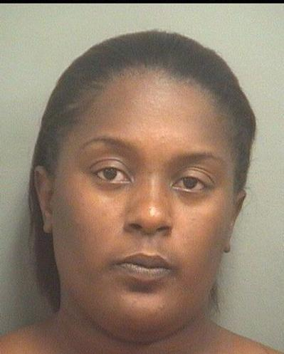 Monique McCellion, 32, of Boynton Beach, is accused taking a child with a severe facial burn from an iron, to a parade, rather than a hospital.
