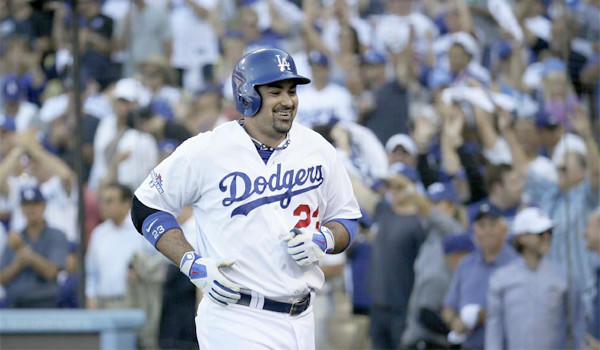 Adrian Gonzalez, who carries one of the most expensive contracts on the Dodgers' roster, smiles after hitting a home run during the National League Championship Series against the St. Louis Cardinals on Oct. 16.