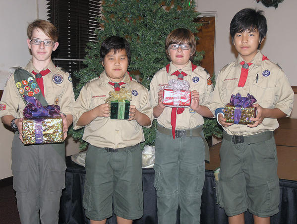 Boy Scouts from Burbank Troop 209 from left, Ryan Loney, David Lee, Dylan Beverly and Brian Lee will be wrapping gifts for donations on the third floor of Sears at the Burbank Town Center.