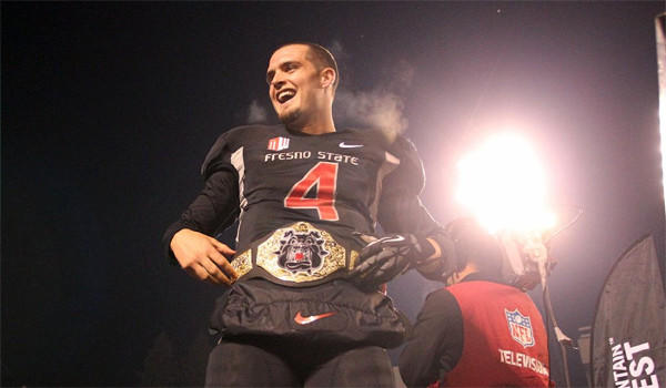 Fresno State quarterback Derek Carr celebrates winning the Mountain West title with a win over Utah State, 24-17, on Dec. 7. Carr and the Bulldogs will face USC in the Las Vegas Bowl on Dec. 21.