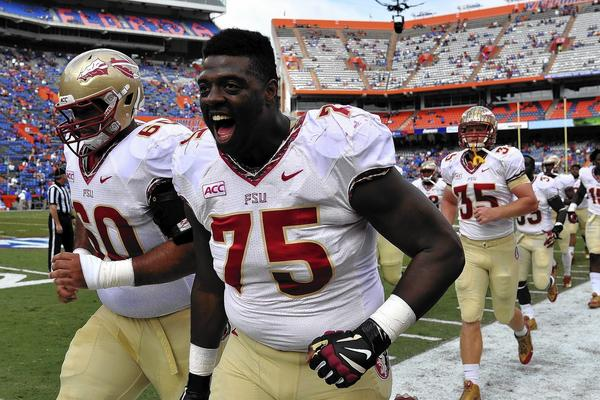 Seminoles offensive linesman Cameron Erving (75) runs off the field before a game against the Florida Gators at Ben Hill Griffin Stadium.