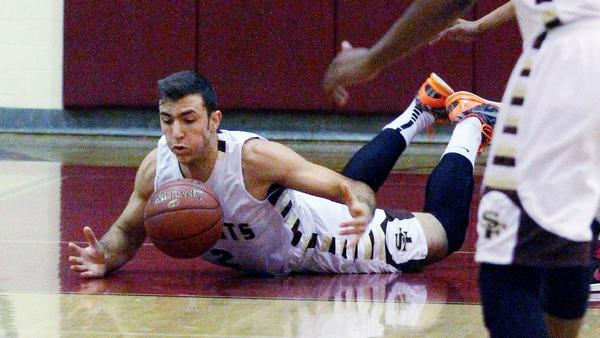 St. Francis' Markar Agakanian dives for a loose ball against Arcadia in the La Caada Holiday Classic boys basketball tournament on Tuesday. (Tim Berger/Staff Photographer)