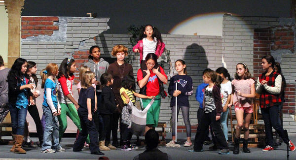 "The cast of orphans, including the leads and the ensemble, rehearse 'Hard Knock Life' during rehearsal of ""Annie"" in the Hall of Liberty at Forest Lawn on Monday, Dec. 16, 2013. They have been rehearsing since October and the show opens this Friday at Forest Lawn, Hollywood Hills in the Hall of Liberty."