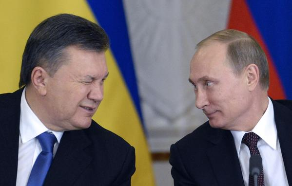 Ukrainian President Viktor Yanukovych winks at Russia's President Vladimir Putin (R) during a signing ceremony at the Kremlin in Moscow.