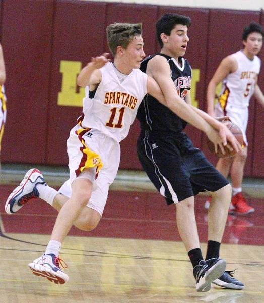 La Cañada's Grant Arthur commits a foul chasing the ball around Glendale's Raffi Jivalagian in the La Cañada Holiday Classic boys' basketball tournament on Tuesday.