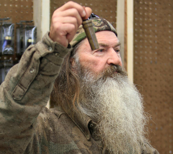 "Phil Robertson, the Duck Commander, holds the 1 millionth duck call assembled for 2013. Robertson assembled the duck call before media and a crowd of tourists at company's warehouse in West Monroe, La., on Nov. 7. Robertson is one of the stars of A&E's ""Duck Dynasty."""