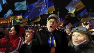 Ukraine announces $15-billion Russia loan, gas price cut