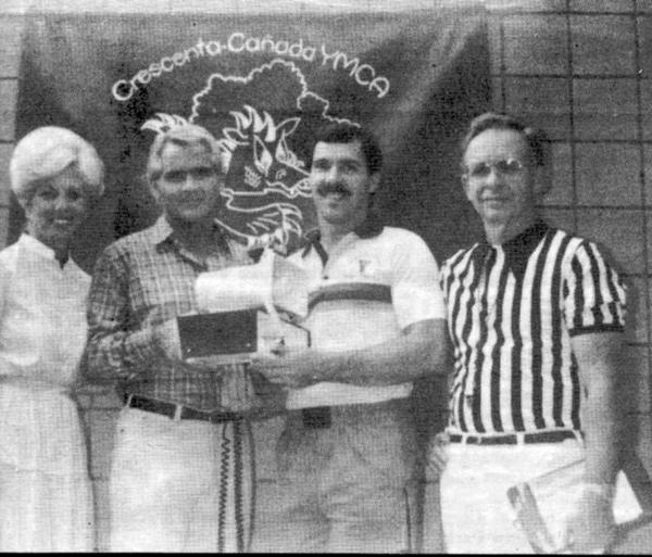 Bonnie and James Damron, from left, present a champion public address starter system to Dragon swim team coach Mark Blangdon and Ken Putman, the official starter for the Crescenta-Canada Family YMCA, in 1983. The Damrons' children Jim, Paige and Shannon were all swimmers at the local Y.