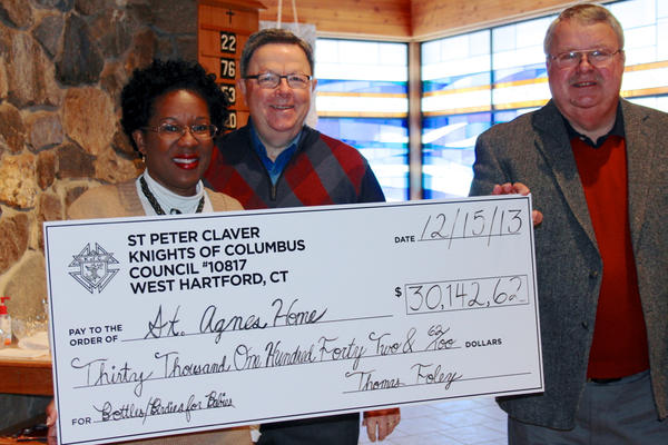 "The Knights of Columbus, Council 10817, based at St. Peter Claver Church, present a $30,142.62 check to St. Agnes Home, which provides residential and support services to pregnant teens and adolescent mothers and their babies. Pictured, from left, are Lorna Little, executive director of St. Agnes Home, Phil Prespare, ""Birdies for Babies"" tournament chairman and Tom Foley, Grand Knight, Council 10817."