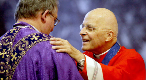 Francis Cardinal George greets Bishop Andrew Wypych during services.