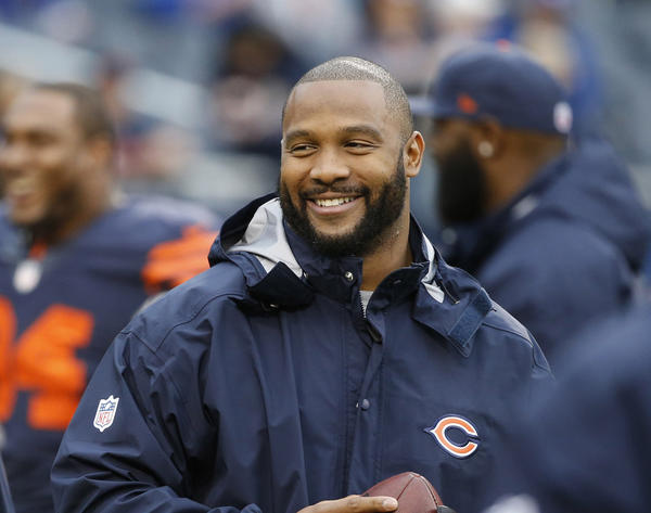 Injured Chicago Bears outside linebacker Lance Briggs (55), right, and injured Chicago Bears cornerback Charles Tillman (33) on the field during pre-game warm ups before a game against the Baltimore Ravens at Soldier Field in Chicago on Sunday, Nov. 17, 2013.