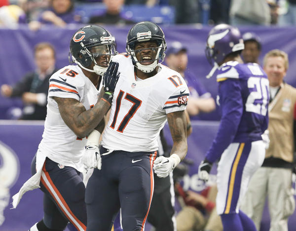 Brandon Marshall celebrates with fellow wide receiver Alshon Jeffery (17) after Jeffery's second touchdown against the Minnesota Vikings.