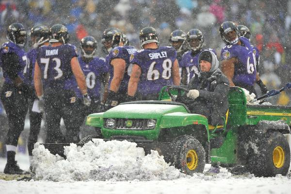 A snowplow plows during a timeout as the Ravens played the Minnesota Vikings at M&T Bank Stadium.