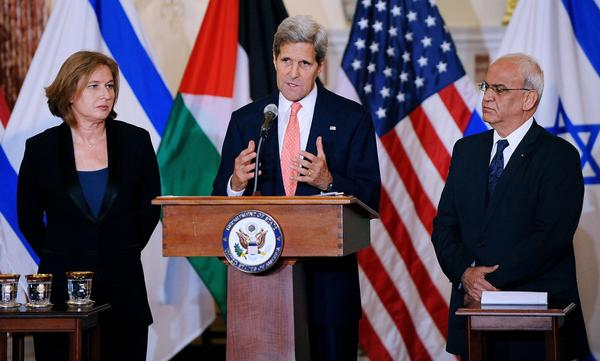 U.S. Secretary of State John F. Kerry is flanked by Israeli Justice Minister Tzipi Livni and Palestinian chief negotiator Saeb Erekat at a news conference on July 30, 2013, after the start of peace talks in Washington.