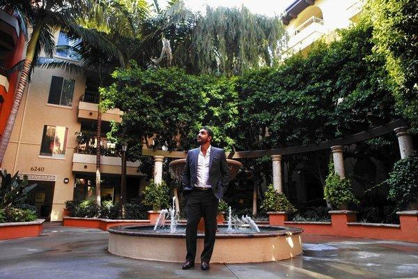 Real estate broker Mauricio Umanksy of the Agency in the courtyard of the Palazzo Apartments in L.A.'s Fairfax district. His firm is marketing a special enclave of luxury apartments called the Penthouses at Palazzo.