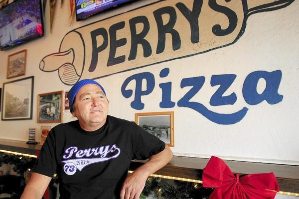Jess Bingaman, 56, has owned Perry's Pizza in Newport Beach since 1996. The 40-year-old pizza parlor is closing early next year, however, because its lease isn't being renewed by the building's new owner.