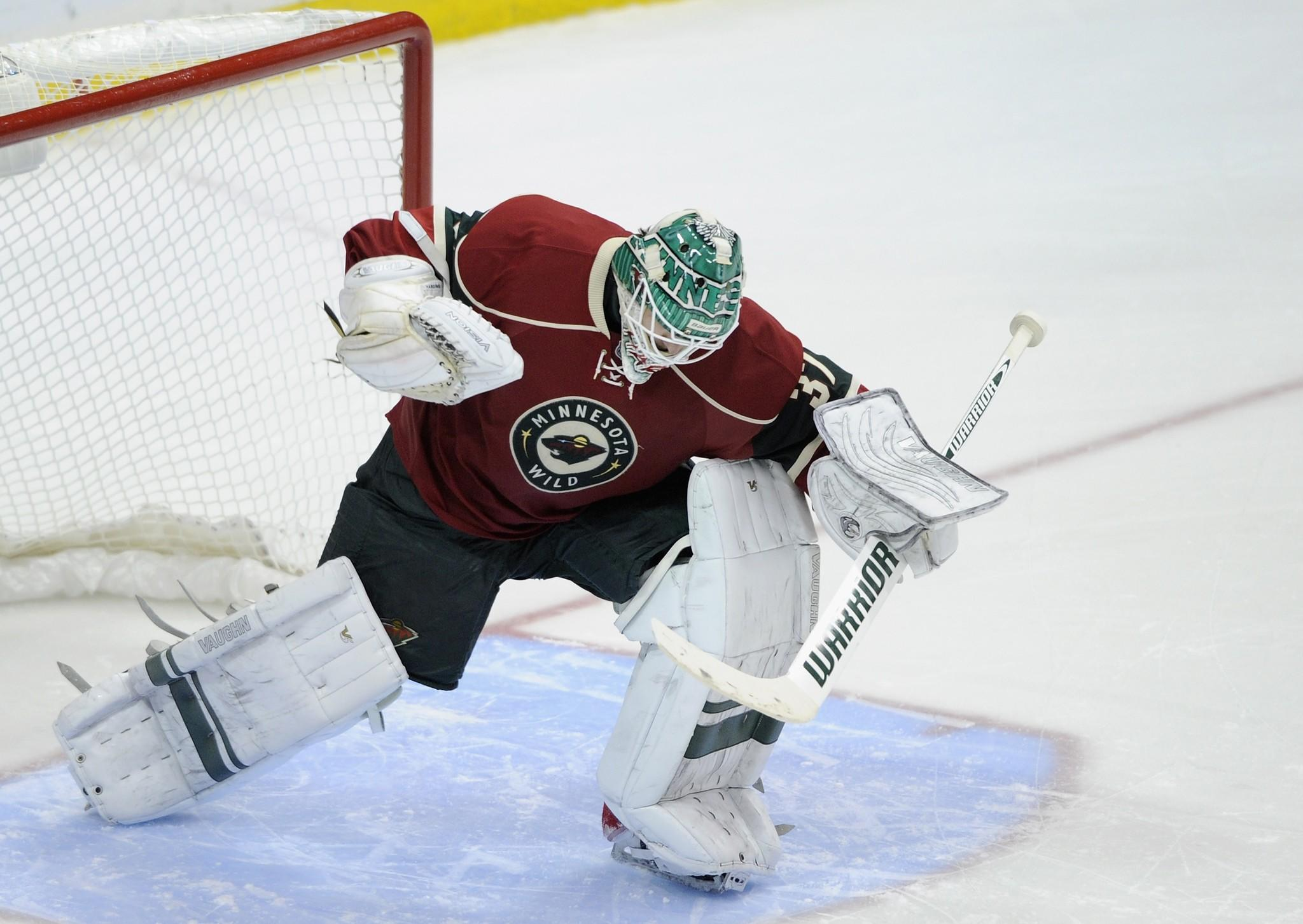 Wild goalie Josh Harding celebrates a win of the game against the Canucks.