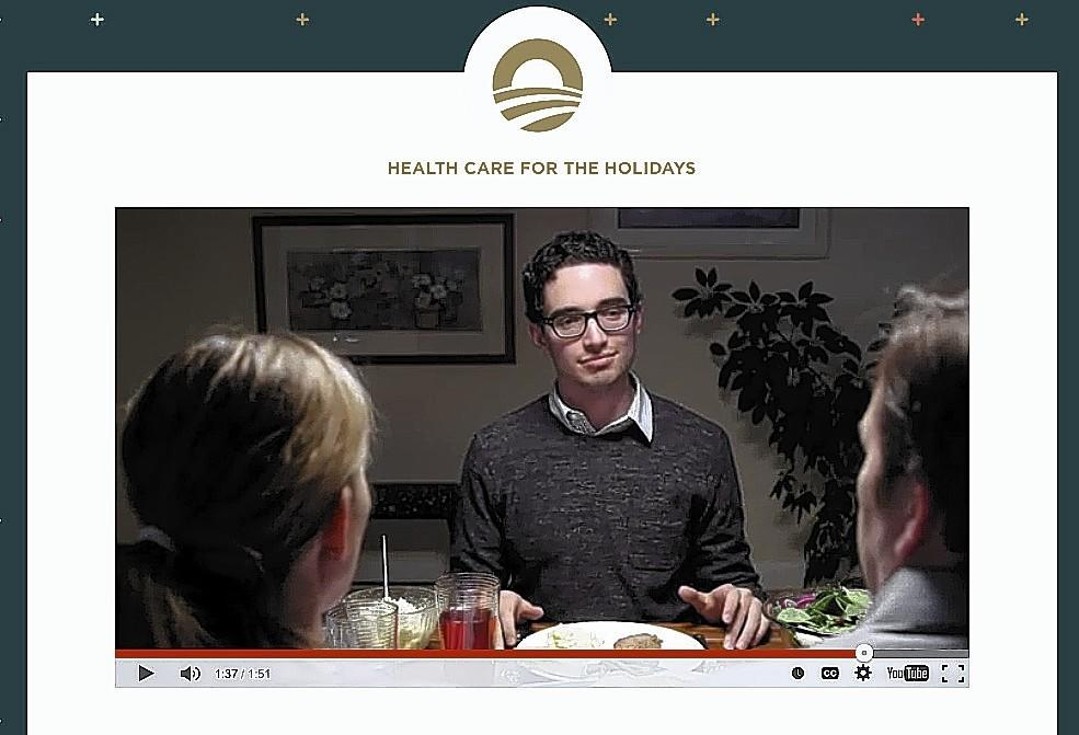 A scene from a holiday-dinner video on the president's website.