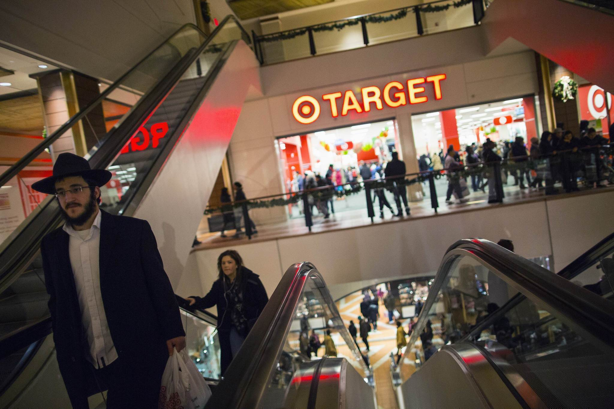 Shoppers are seen at a Target store during Black Friday sales in the Brooklyn borough of New York, in this November 29, 2013, file photo. Target Corp said data from about 40 million credit and debit cards might have been stolen from shoppers at its stores during the first three weeks of the holiday season, in the second-largest card breach at a U.S. Retailer.