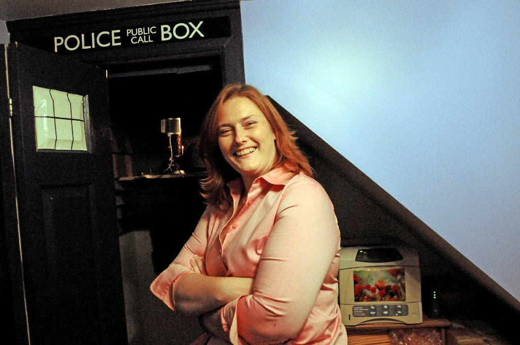 Kate Baker stands by the recording studio built for her by her brother Evan which resembles the public call box which the science fiction character Doctor Who.