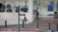 Man in custody after brief standoff outside U.S. courthouse