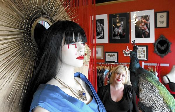 Denise Levesque looks at the life-size Virgin Mary mannequin display at her Sin is Pretty vintage store in Laguna. The interpretation of the Our Lady of Guadalupe has been getting some looks from around the neighborhood.