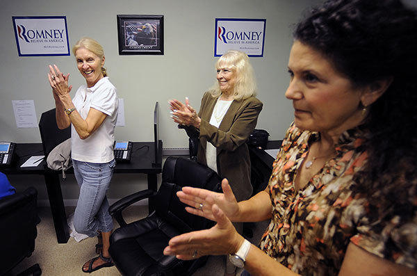 Volunteers at Mitt Romney's new Broward County office applaud a speaker's comments during the opening of the candidate's office Wednesday afternoon. L-R are Dolores Radcliffe, Bunney Brenneman, and Helene T. Robinson.