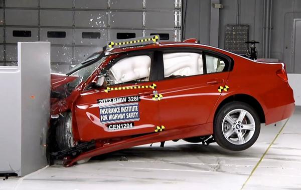 A BMW 328i undergoes a crash test conducted by the Insurance Institute of Highway Safety.