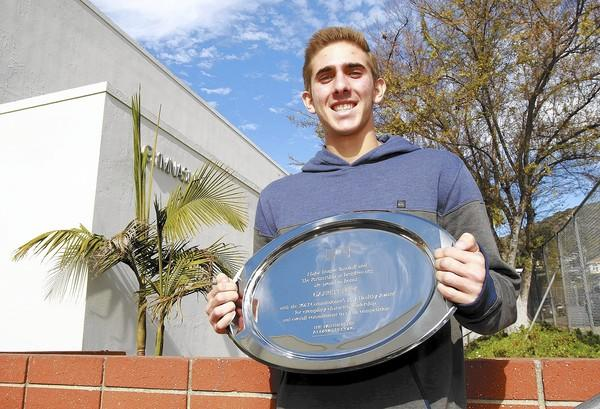 Laguna Beach High School senior Garrett Burk received an award from the Major League Baseball commissioner's office for his dedication to educating people on dangers of prescription drug abuse.