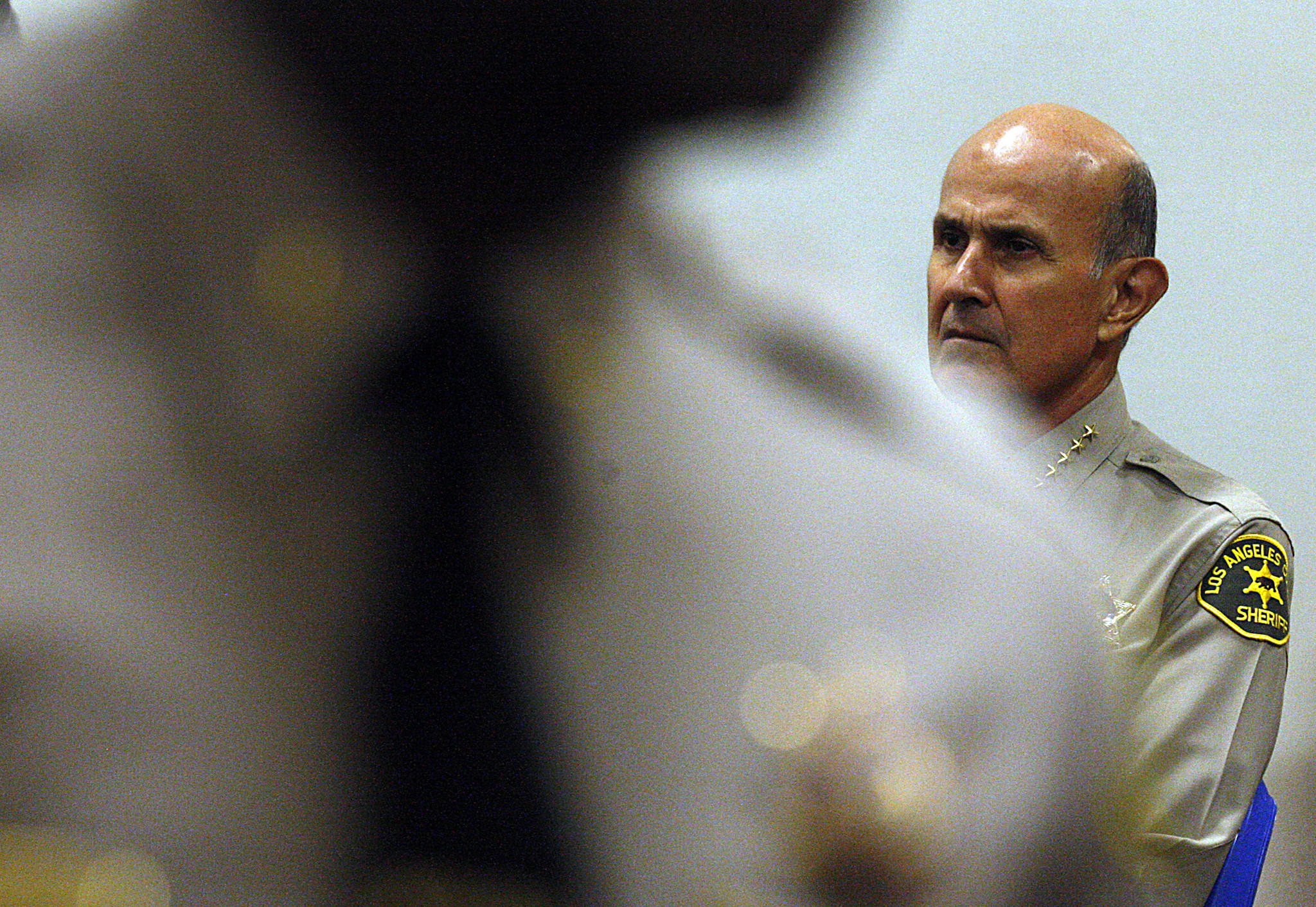 Sheriff Lee Baca did not know about his nephew's past brushes with the law, his spokesman said.
