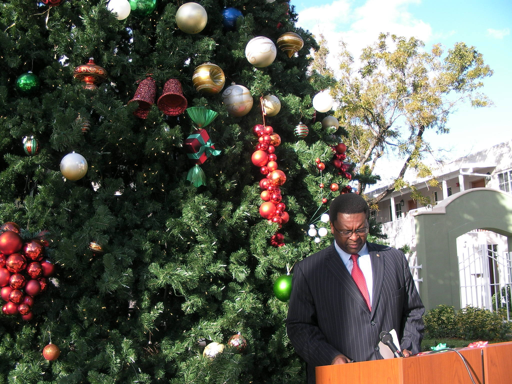 State Rep. Perry Thurston, a Broward Democrat and his party's leader in the Florida House, prepares for a press conference on Thursday, Dec. 19, 2013, in front of the Christmas tree at Alan Clubhouse Plaza on Sistrunk Boulevard in Fort Lauderdale. (Photo by Anthony Man/Sun Sentinel.)