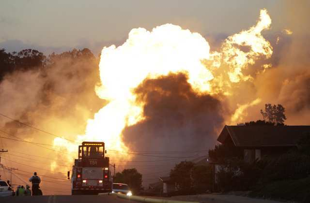 A massive fire roars through San Bruno, Calif., after a PG&E natural gas pipeline explosion.
