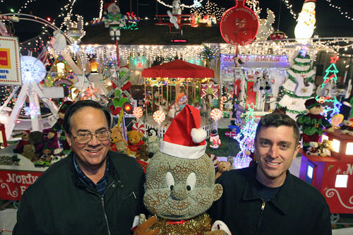 Neighbors Dick Norton and Keith LaPrath pose in front of Norton's front lawn with a Elmer Fudd statue the two try to plant in each other's Christmas decorations.  Photographed on Wednesday, December 18, 2013.