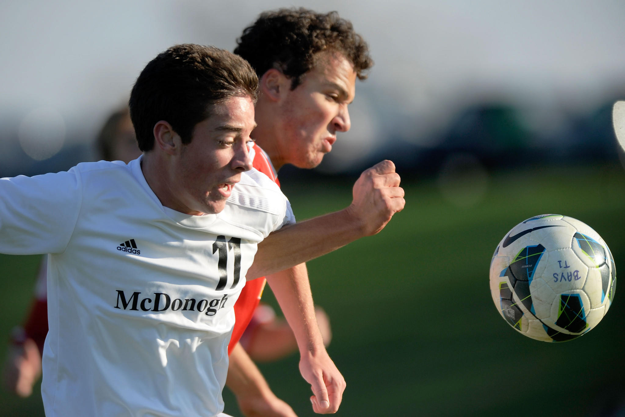 McDonogh's Jack Settleman and Calvert Hall's Dominic Fullano vie for a ball in the first half of their A Conference semifinal match.