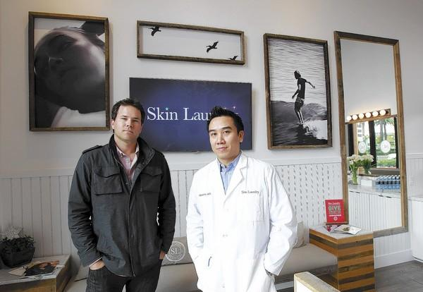 Chris Carey, CEO, left, and Elson Lai MD, at Fashion Island's Skin Laundry, which offers 10-minute laser facials to clients.