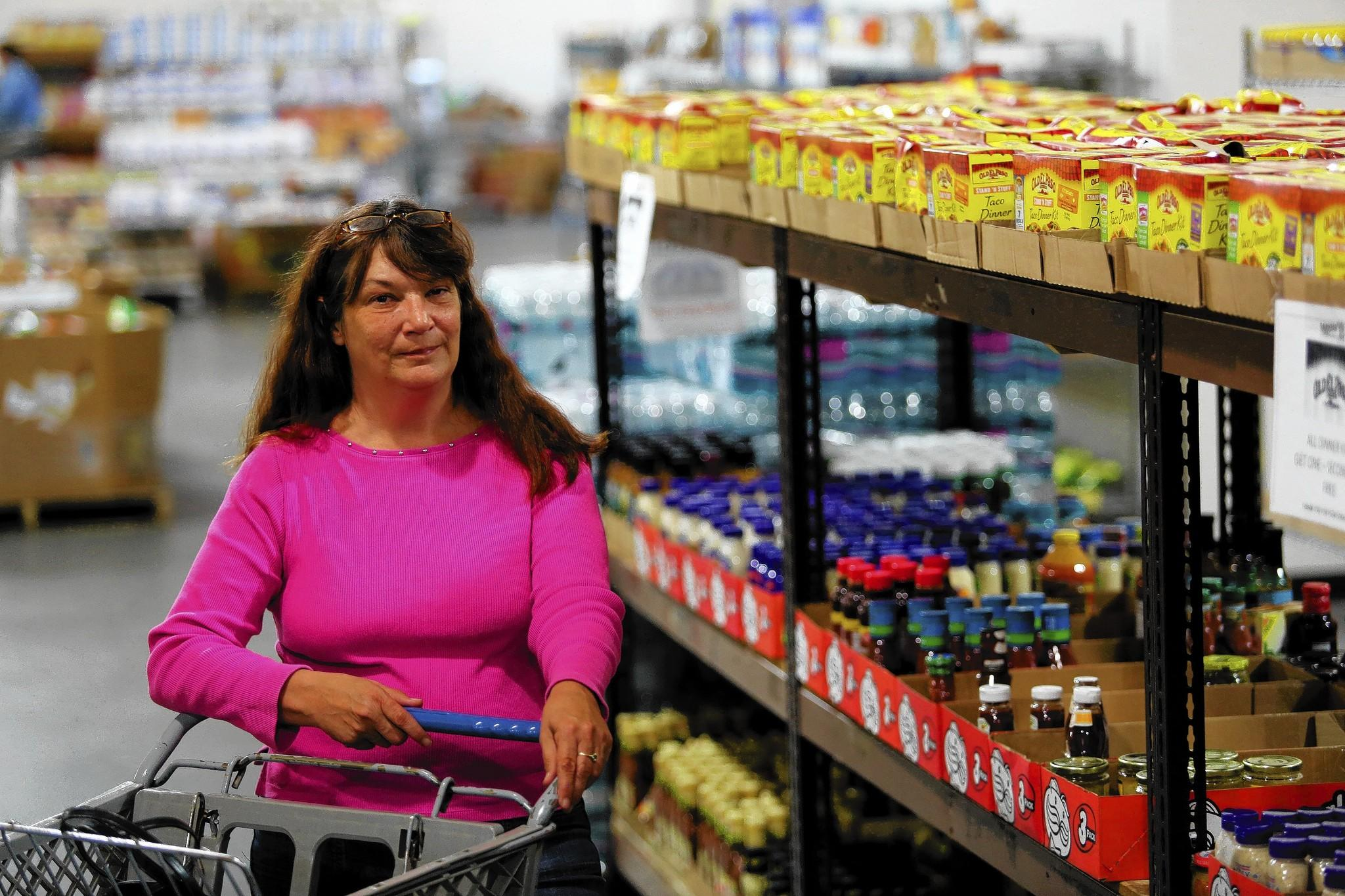 Michele Turkington shops at Harvest Time International in Sanford.