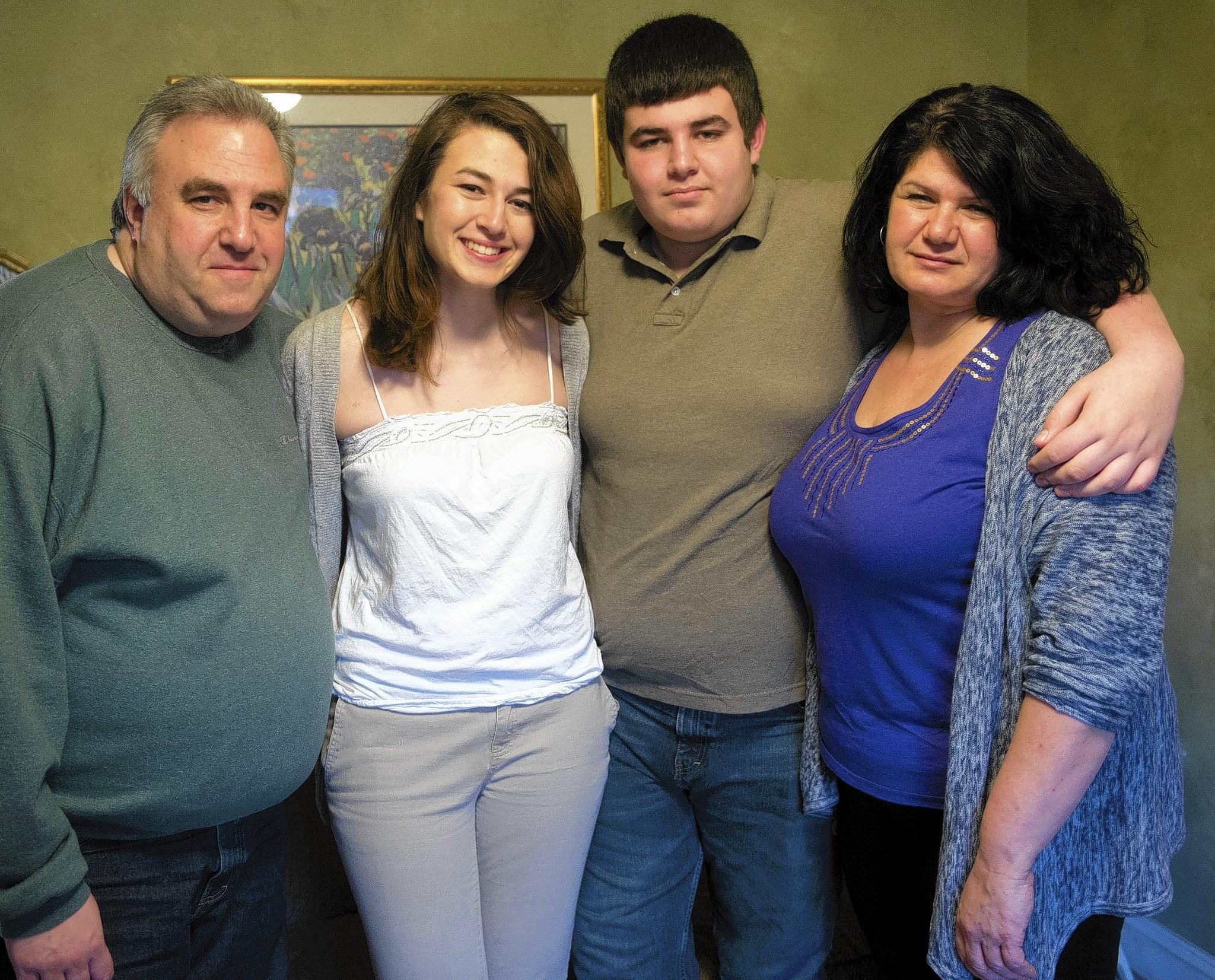 Brandon Silk poses with (from left) his father Erik, sister Bridget and mother Rosa. Brandon has had severe allergic reactions to the Axe perfume spray at Bethlehem's Freedom High School.