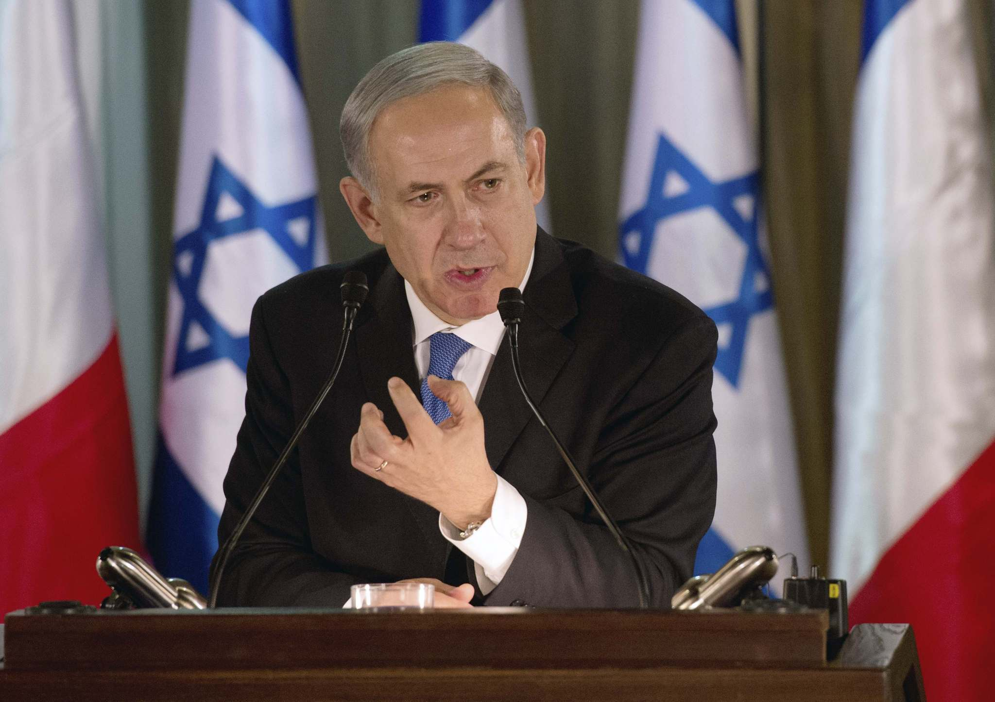 Israel Prime Minister Benjamin Netanyahu speaks during a joint news conference with French President Francois Hollande (not pictured) at his residence in Jerusalem November 17, 2013. President Hollande assured Israel on Sunday that France would continue to oppose an easing of economic sanctions against Iran until it was convinced Tehran had ended a pursuit of nuclear weapons.