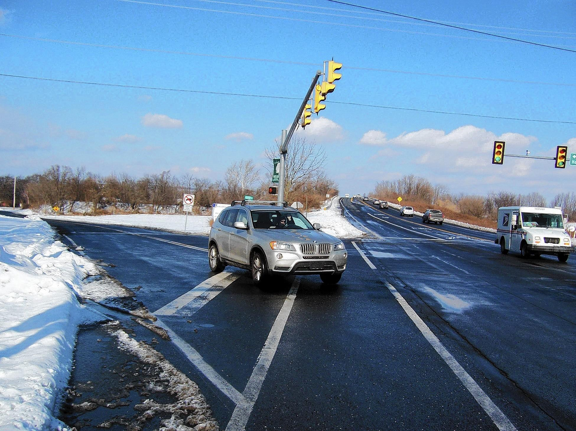 A motorist considers turning right on red from Snowdrift Road onto Airport Road in East Allen Township. Right on red is allowed, despite the hard angle required for looking back to the left for conflicting traffic.
